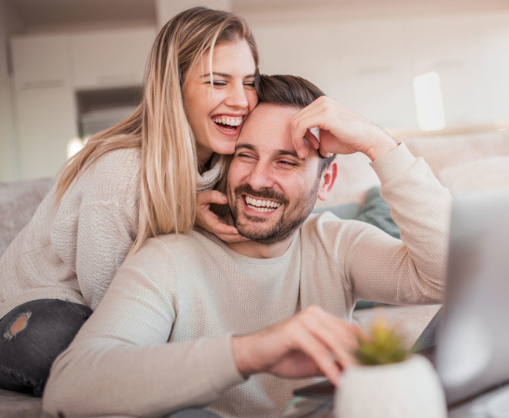 happy-couple-applying-for-second-mortgage