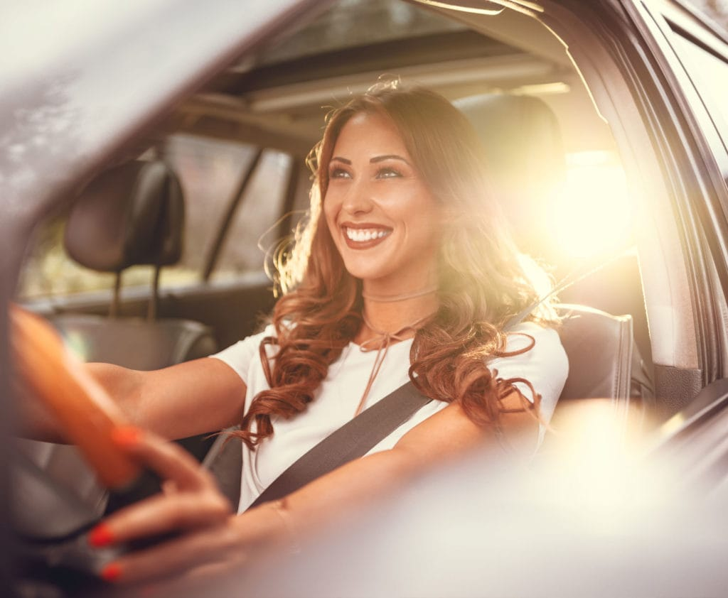 woman-driving-car-purchased-with-car-loan